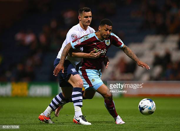 Andre Gray of Burnley holds off a challenge from Bailey Wright of Preston North End during the Sky Bet Championship match between Preston North End...