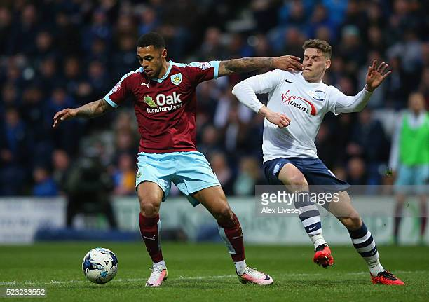 Andre Gray of Burnley holds off a challenge from Calum Woods of Preston North End during the Sky Bet Championship match between Preston North End and...