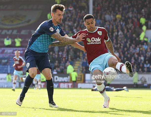 Andre Gray of Burnley holds off Grant Hall of QPR during the Sky Bet Championship match between Burnley and Queens Park Rangers at Turf Moor on May 2...