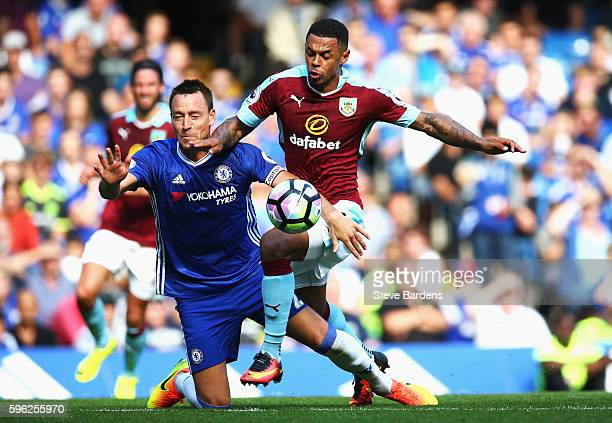 Andre Gray of Burnley is challenged by John Terry of Chelsea during the Premier League match between Chelsea and Burnley at Stamford Bridge on August...