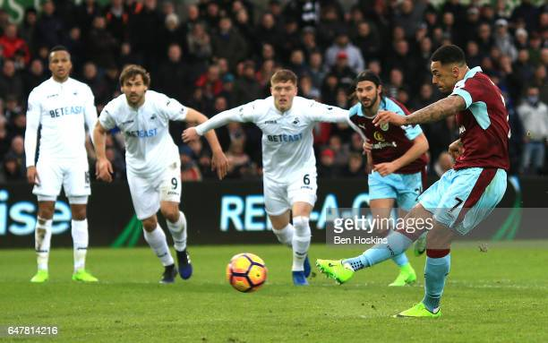 Andre Gray of Burnley scores his sides first goal from the penalty spot during the Premier League match between Swansea City and Burnley at Liberty...