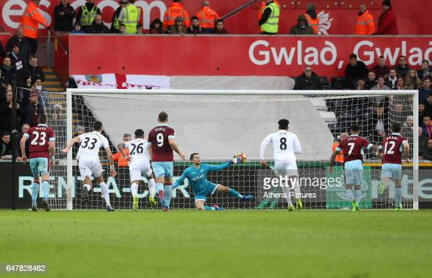 Andre Gray of Burnley scores his sides first goal of the match during the Premier League match between Swansea City and Burnley at The Liberty...