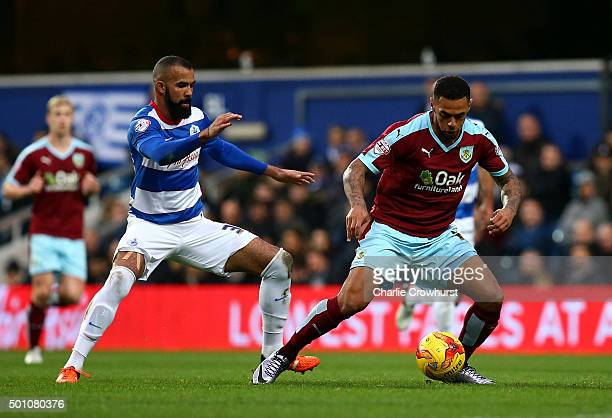 Andre Gray of Burnley shields the ball from QPR's Sandro during the Sky Bet Championship match between Queens Park Rangers and Burnley at Loftus Road...