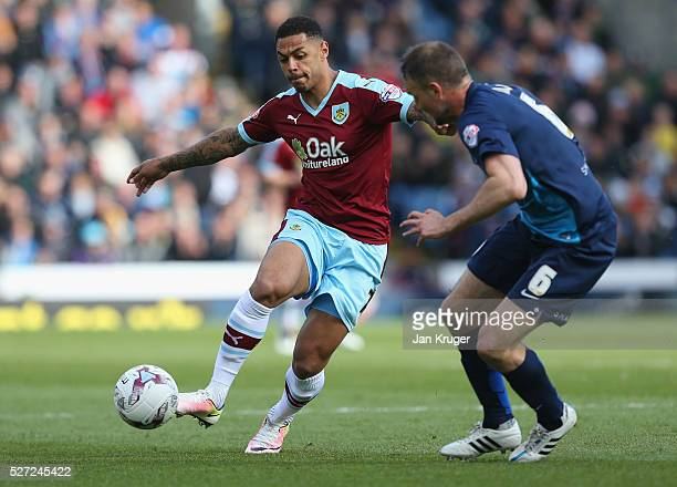 Andre Gray of Burnley takes on Clint Hill of QPR during the Sky Bet Championship match between Burnley and Queens Park Rangers at Turf Moor on May 2...