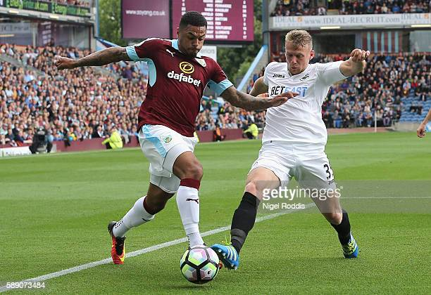 Andre Gray of Burnley takes on Stephen Kingsley of Swansea City during the Premier League match between Burnley and Swansea City at Turf Moor on...