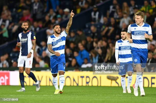 Andre Gray of Queens Park Rangers celebrates after scoring their team's first goal during the Sky Bet Championship match between West Bromwich Albion...