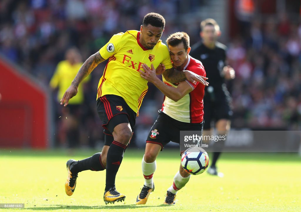 Andre Gray of Watford and Cedric Soares of Southampton in action during the Premier League match between Southampton and Watford at St Mary's Stadium on September 9, 2017 in Southampton, England.