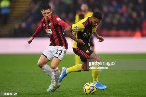 Andre Gray of Watford and Harry Wilson of Bournemouth in action during the Premier League match between Watford FC and AFC Bournemouth at Vicarage...
