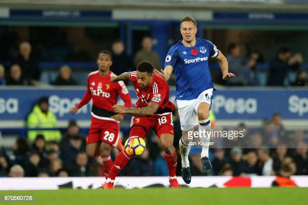 Andre Gray of Watford and Phil Jagielka of Everton battle for possession during the Premier League match between Everton and Watford at Goodison Park...