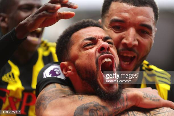 Andre Gray of Watford celberates after scoring his sides second goal during the Premier League match between Watford FC and Leicester City at...