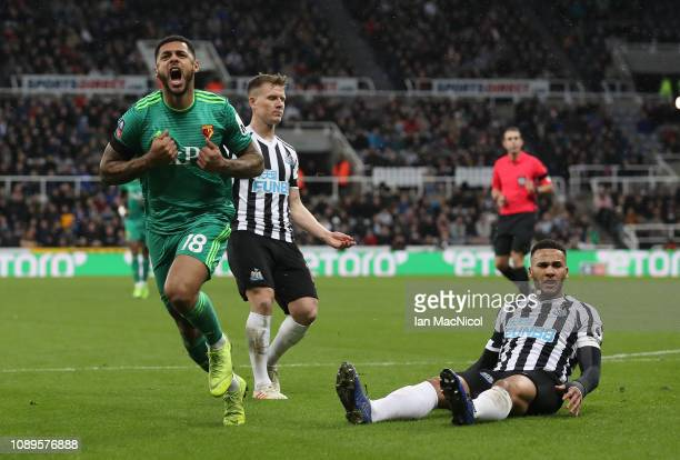 Andre Gray of Watford celebrates after he scores his team's opening goal during the FA Cup Fourth Round match between Newcastle United and Watford at...