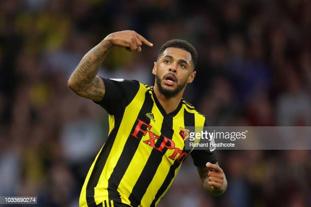 Andre Gray of Watford celebrates after scoring his team's first goal during the Premier League match between Watford FC and Manchester United at...