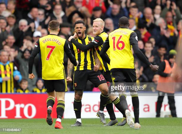 Andre Gray of Watford celebrates after scoring his team's first goal witjh team mates during the Premier League match between Watford FC and...