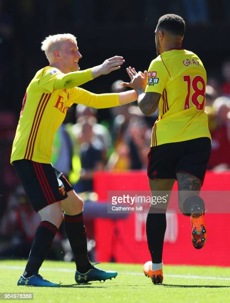 Andre Gray of Watford celebrates scoring his side's second goal with team mate Will Hughes during the Premier League match between Watford and...