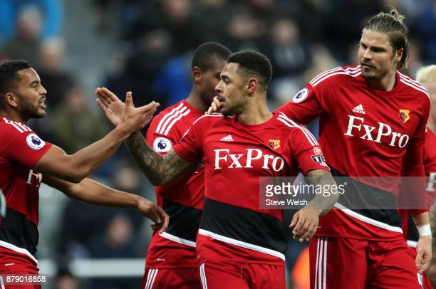 Andre Gray of Watford celebrates scoring his sides third goal with his Watford team mates during the Premier League match between Newcastle United...