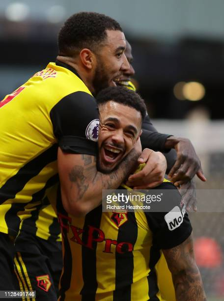 Andre Gray of Watford celebrates scoring the first goal during the Premier League match between Watford FC and Everton FC at Vicarage Road on...