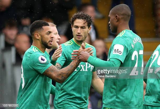 Andre Gray of Watford celebrates with team mates after scoring his sides first goal during the Premier League match between Fulham FC and Watford FC...