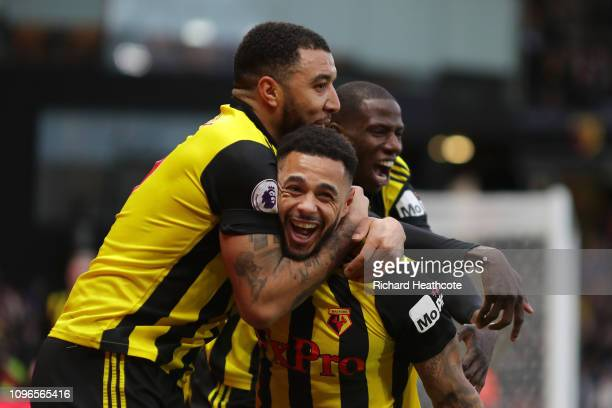 Andre Gray of Watford celebrates with teammates after scoring his team's first goal during the Premier League match between Watford FC and Everton FC...