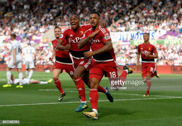 Andre Gray of Watford celerbates scoring the opening goal with his team mate Andre Carrilo during the Premier League match between Swansea City and...