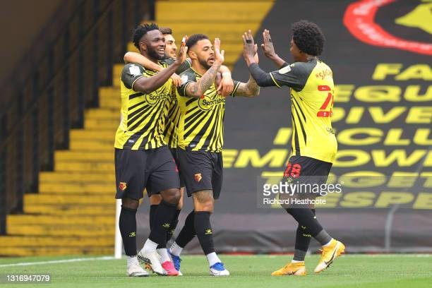 Andre Gray of Watford FC celebrates after scoring their team's first goal with Carlos Sanchez and Isaac Success during the Sky Bet Championship match...