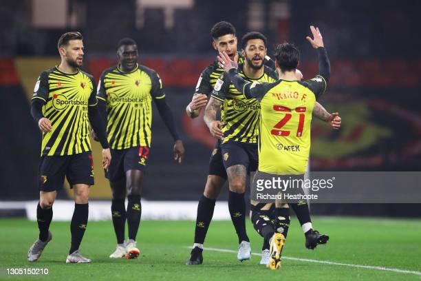 Andre Gray of Watford FC celebrates with teammate Kiko Femenia after scoring their team's first goal during the Sky Bet Championship match between...