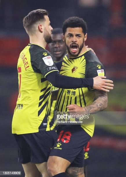 Andre Gray of Watford FC celebrates with teammate Philip Zinckernagel after scoring their team's first goal during the Sky Bet Championship match...
