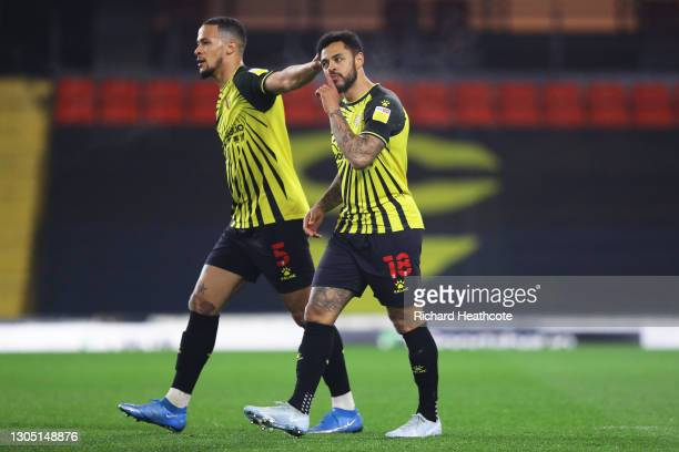 Andre Gray of Watford FC celebrates with teammate William Troost-Ekong after scoring their team's first goal during the Sky Bet Championship match...