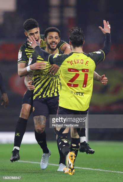 Andre Gray of Watford FC celebrates with teammates Kiko Femenia and Adam Massina after scoring their team's first goal during the Sky Bet...