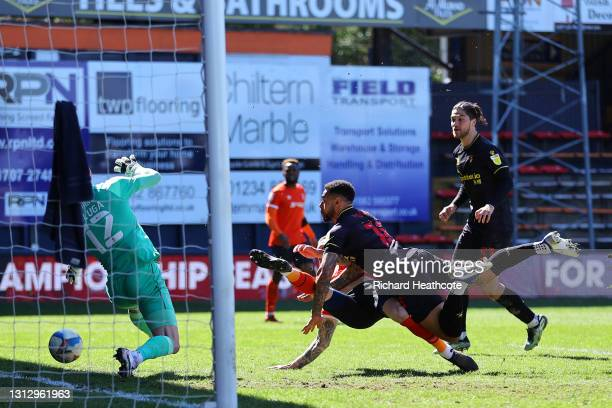 Andre Gray of Watford FC scores a goal which was later disallowed during the Sky Bet Championship match between Luton Town and Watford at Kenilworth...