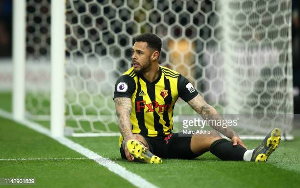 Andre Gray of Watford reacts after missing a chance at goal during the Premier League match between Watford FC and Arsenal FC at Vicarage Road on...