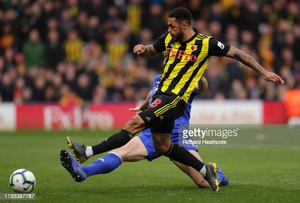 Andre Gray of Watford scores his sides second goal during the Premier League match between Watford FC and Leicester City at Vicarage Road on March 03...