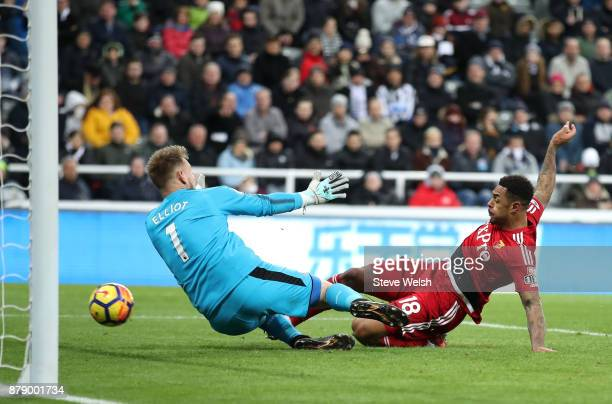 Andre Gray of Watford scores his sides third goal past Robert Elliot of Newcastle United during the Premier League match between Newcastle United and...