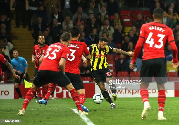 Andre Gray of Watford scores his team's first goal during the Premier League match between Watford FC and Southampton FC at Vicarage Road on April 23...