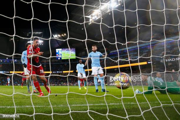 Andre Gray of Watford scores his teams first goal during the Premier League match between Manchester City and Watford at Etihad Stadium on January 2...