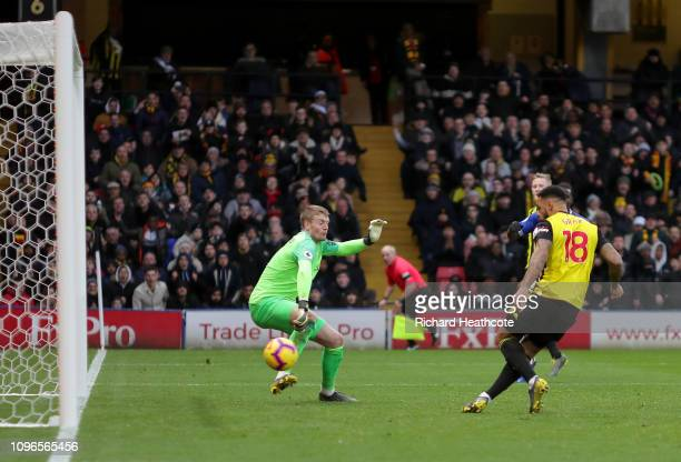 Andre Gray of Watford scores his team's first goal past Jordan Pickford of Everton during the Premier League match between Watford FC and Everton FC...