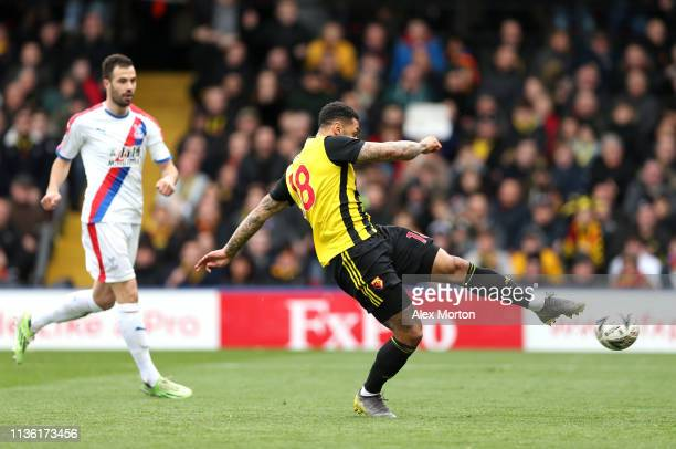 Andre Gray of Watford scores his team's second goal during the FA Cup Quarter Final match between Watford and Crystal Palace at Vicarage Road on...