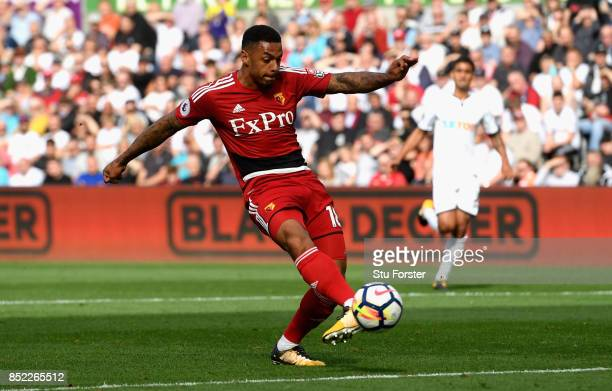 Andre Gray of Watford scores the opening goal during the Premier League match between Swansea City and Watford at Liberty Stadium on September 23...