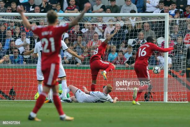 Andre Gray of Watford scores the opening goal during the Premier League match between Swansea City and Watford at The Liberty Stadium on September 23...