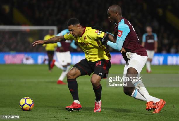 Andre Gray of Watford shields the ball from Angelo Ogbonna of West Ham United during the Premier League match between Watford and West Ham United at...