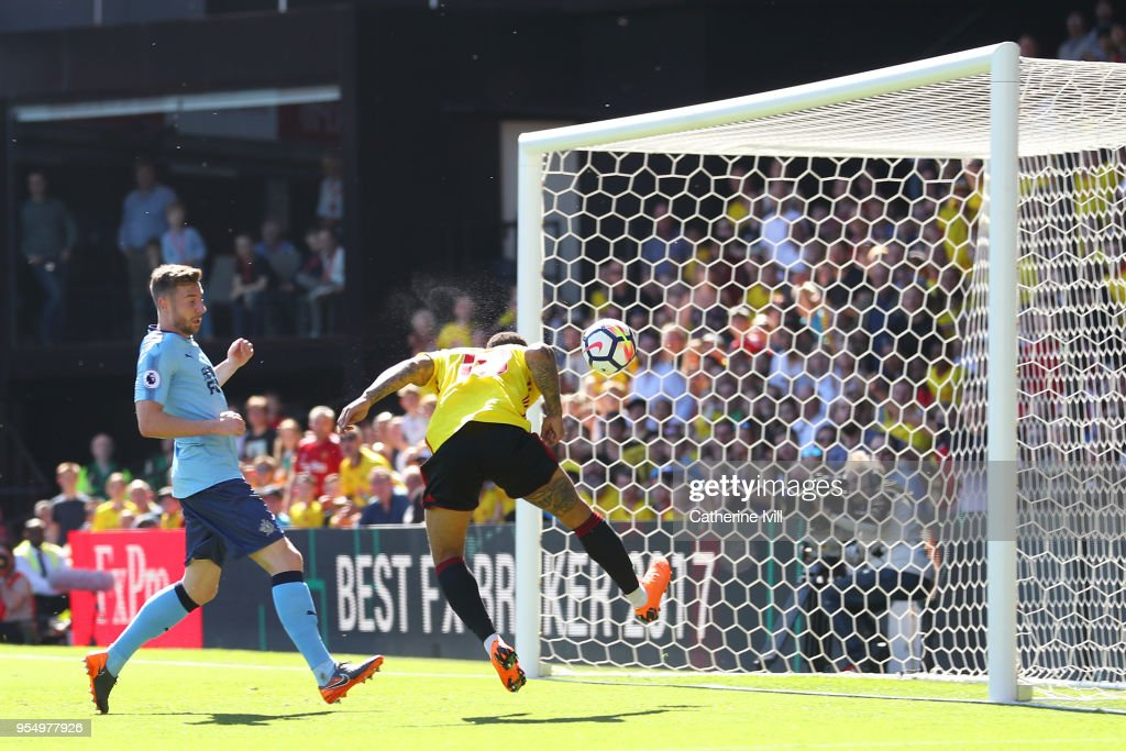 Andre Gray of Watford shoots and scores his side's second goal during the Premier League match between Watford and Newcastle United at Vicarage Road on May 5, 2018 in Watford, England.