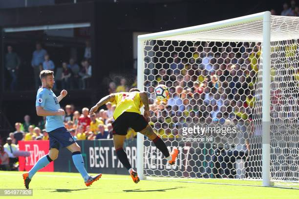 Andre Gray of Watford shoots and scores his side's second goal during the Premier League match between Watford and Newcastle United at Vicarage Road...