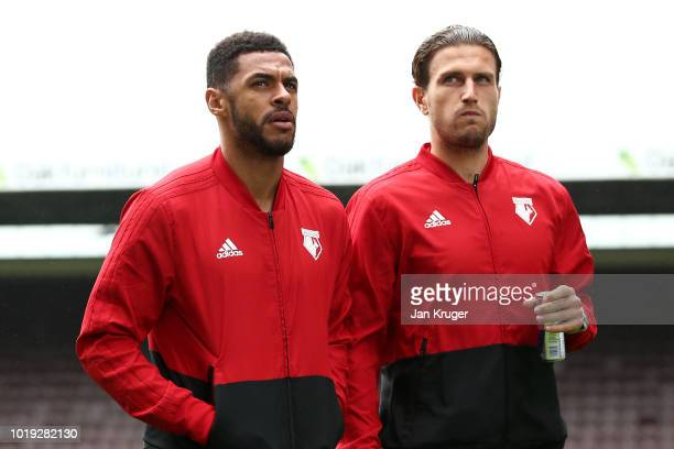 Andre Gray of Watford speaks with Daryl Janmaat of Watford during a pitch inspection prior to the Premier League match between Burnley FC and Watford...