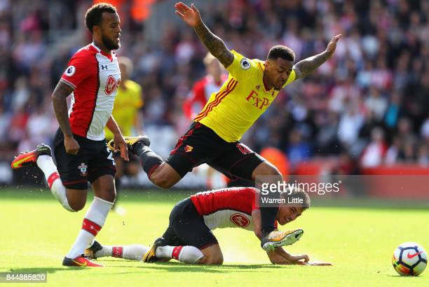 Andre Gray of Watford takes on Cedric Soares and Ryan Bertrand of Southampton in action during the Premier League match between Southampton and...