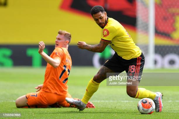 Andre Gray of Watford takes on Emil Krafth of Newcastle United during the Premier League match between Watford FC and Newcastle United at Vicarage...