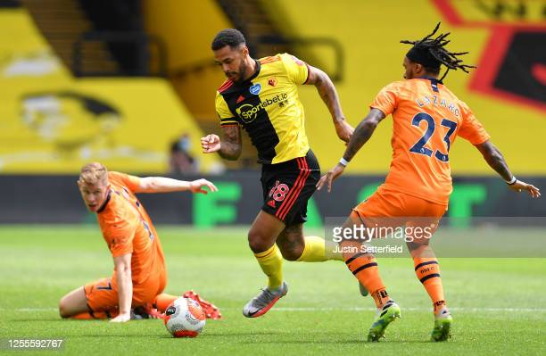 Andre Gray of Watford takes on Valentino Lazaro of Newcastle United during the Premier League match between Watford FC and Newcastle United at...