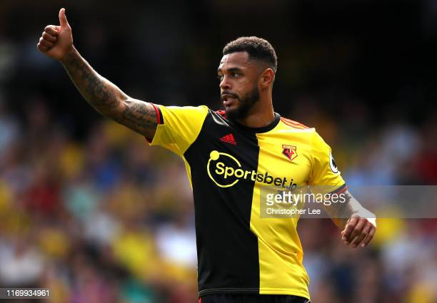 Andre Gray of Watford thanks his teammate for a pass during the Premier League match between Watford FC and West Ham United at Vicarage Road on...