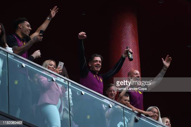 Andre Green Jack Grealish and Alan Hutton of Aston Villa celebrate from the hotel balcony with their fans following their victory in the Sky Bet...