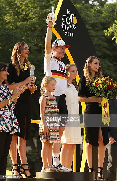 Andre Greipel of Germany and Lotto Soudal celebrates on the podium with his daughters Sophia Anna Greipel Luna Malou Greipel winning stage 21 last...