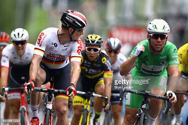 Andre Greipel of Germany and Lotto Soudal looks acrross at Mark Cavendish of Great Britain and Team Dimension Data after losing to him on stage three...
