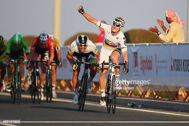 Andre Greipel of Germany and LottoBelisol celebrates winning stage five of the 2014 Tour of Qatar from Al Zubara Fort to Madinat Al Shamal on...